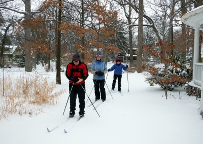 Skiers on a path near the Circle