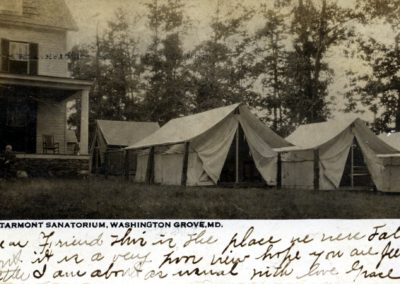 Starmont Sanatorium with tents on its front lawn.